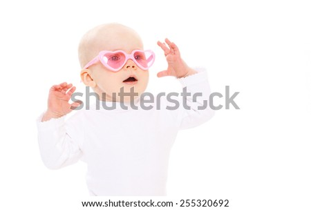 Portrait of funny baby in the pink glasses