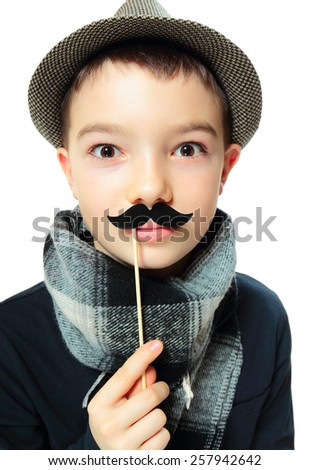 Portrait of funny boy with party mustache on white background - stock photo