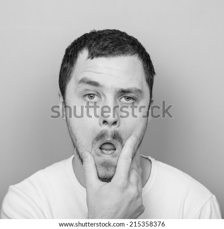 Portrait of funny clueless man - Monocrome or black and white portrait - stock photo