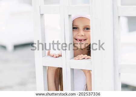 Portrait of funny lovely little girl smiling with changing teeth - stock photo