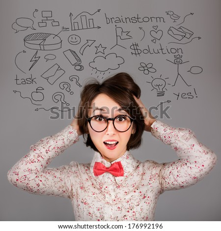 Portrait of Funny Surprised Hipster Girl with Many Ideas. Brainstorm Workflow Concept. - stock photo