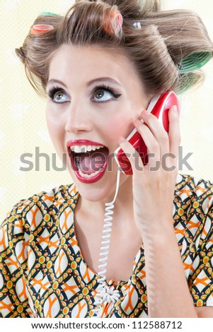 Portrait of funny surprised woman using telephone. - stock photo
