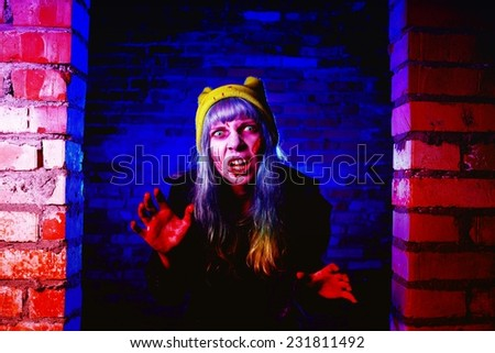 Portrait of funny zombie girl in halloween time - stock photo