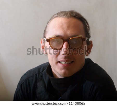 Portrait of funy man with worker dust eyeglasses
