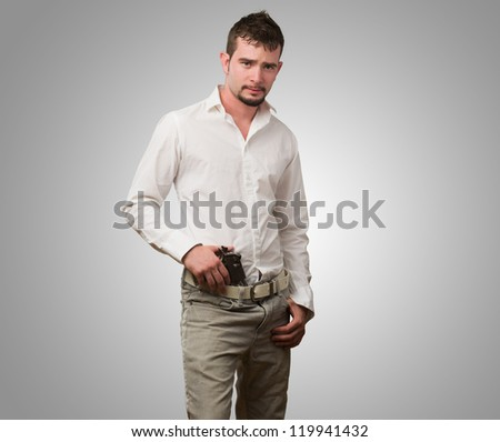 Portrait Of Gangster against a grey background - stock photo