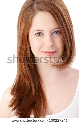 Portrait of gingerish teenage girl with long hair smiling. - stock photo