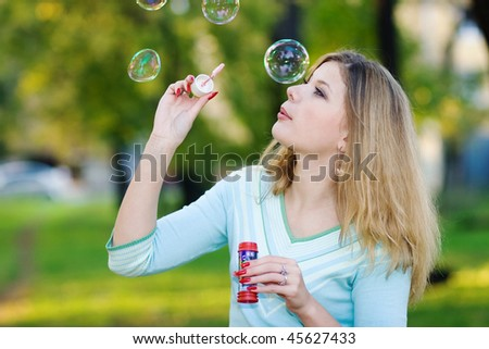 portrait of girl blowing bubbles
