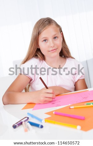 Portrait Of Girl Drawing With Colorful Markers At Home