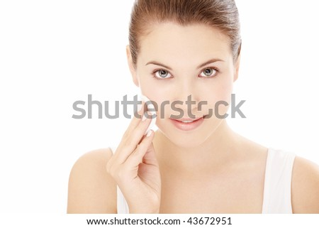Portrait of girl having the face processing, isolated on a white background - stock photo