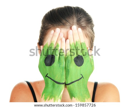 Portrait of girl hiding her face under smile mask isolated on white - stock photo