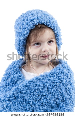 Portrait of girl in a blue winter hat and scarf isolated on white background - stock photo