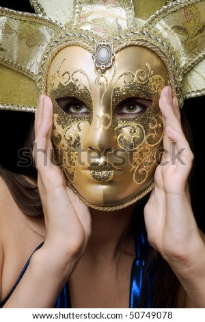 Portrait of girl in a Venetian mask. Isolated