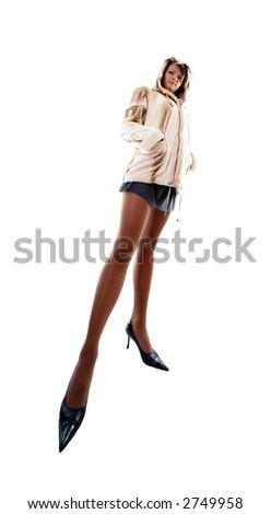Portrait of girl in fur coat on white background - stock photo