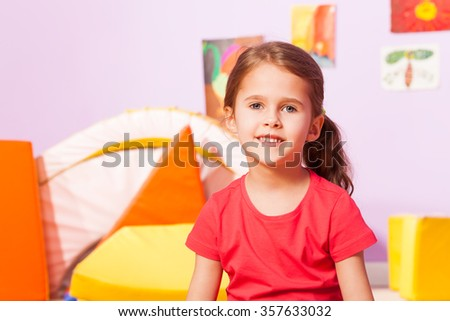 Portrait of girl in kindergarten room - stock photo