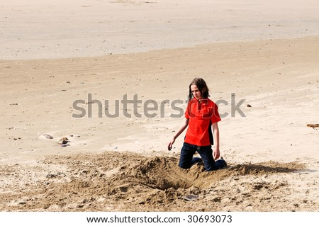 portrait of girl in sand at the beach - stock photo
