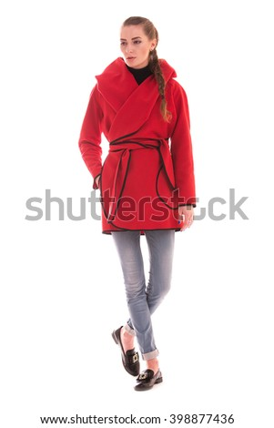 Portrait of girl in Studio on white background. Fashion coat. - stock photo