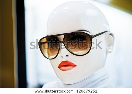 Portrait of girl mannequin wearing sunglasses.