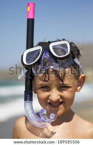 Portrait of Girl on a beach wearing snorkeling equipment - stock photo