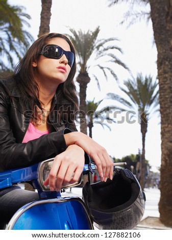 Portrait of girl on scooter - stock photo