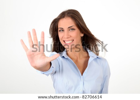 Portrait of girl showing hand to camera - stock photo
