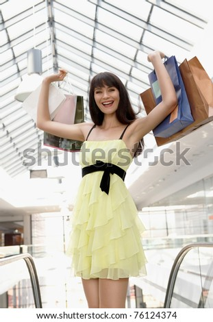 Portrait of girl standing in the mall after doing shopping - stock photo