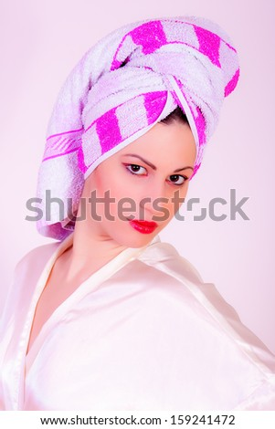 portrait of girl wearing towel on her head - stock photo