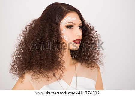 Portrait of girl with afro hairstyle and artistic make up  - stock photo