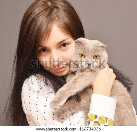 portrait of girl with cat - stock photo