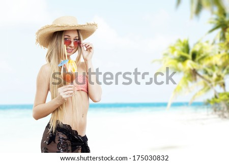 portrait of girl with cocktails, on the beach
