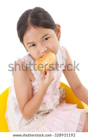 portrait of girl with donut - stock photo