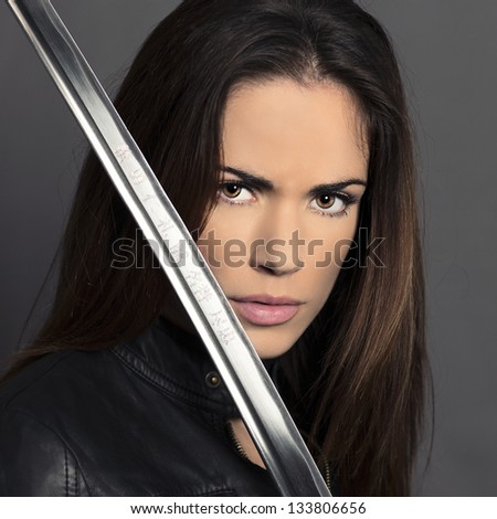 Portrait of girl with Katana in studio - stock photo