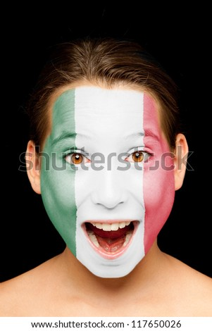portrait of girl with mexican flag painted on her face - stock photo