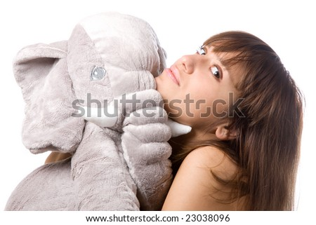 portrait of girl with soft toy (elephant) on white