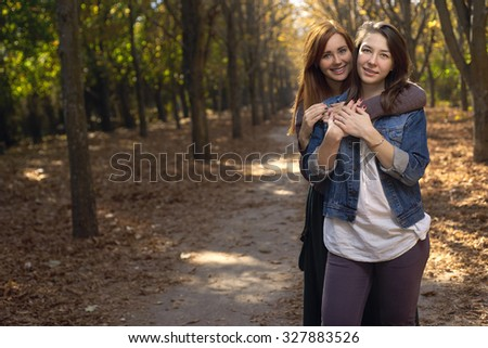 Portrait of girlfriends outdoors - stock photo