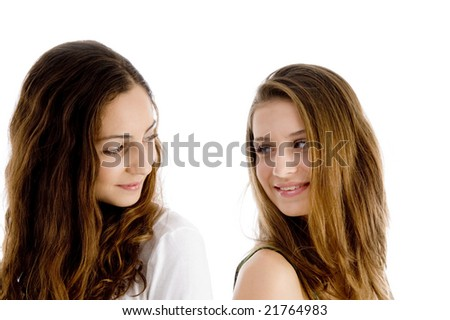 portrait of girls looking to each other on an isolated background - stock photo
