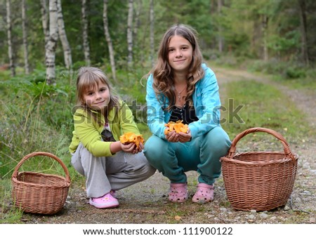 Portrait of girls picking mushrooms - stock photo