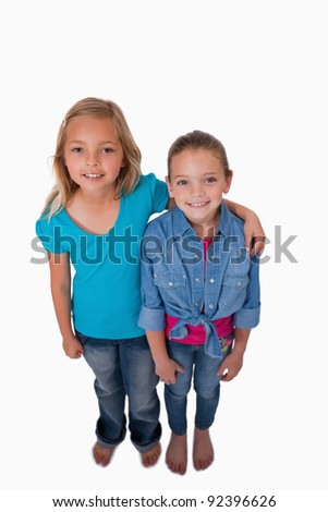 Portrait of girls posing against a white background - stock photo