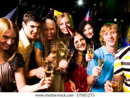 Portrait of glad people in smart clothing with champagne at birthday party - stock photo