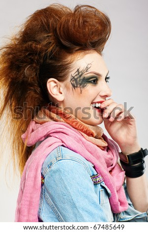 portrait of glam punk redhead girl posing
