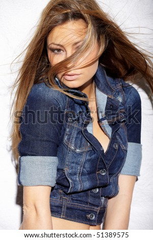 Portrait of glamorous young lady near white wall - stock photo