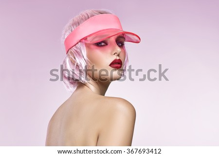 Portrait of glamour girl with red lips isolated on pink background - stock photo