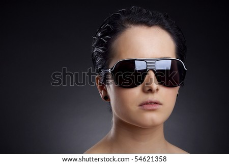 Portrait of glamour woman in black fashion sunglasses