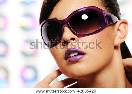 Portrait of glamour woman in purple fashion sunglasses - stock photo