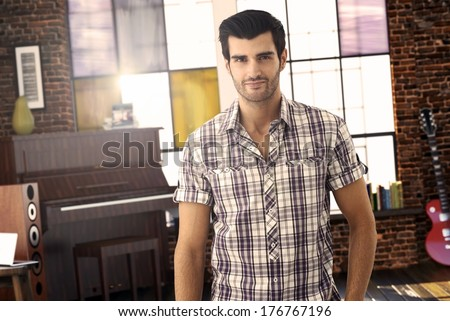 portrait of good looking young musician at stylish home. - stock photo
