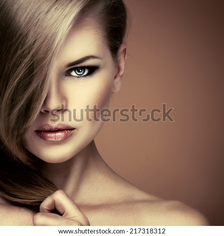 Portrait of gorgeous blue eyed woman with luxury hair looking at camera.  - stock photo