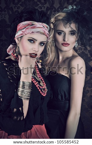 Portrait of gorgeous gypsy woman with another women