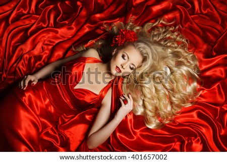 Portrait of gorgeous model in red clothing
