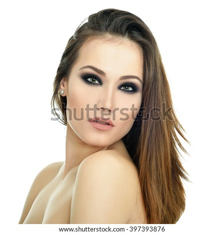 Portrait of gorgeous woman. Pretty girl over white background. Beautiful female face. Skincare, beauty treatment, spa, suntan, cosmetology. - stock photo