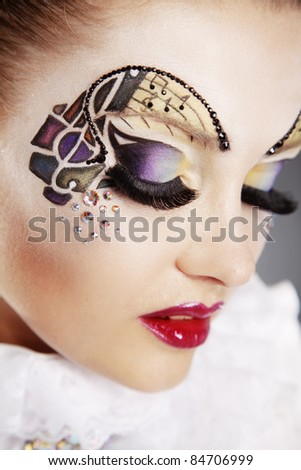 Portrait of gorgeous woman with stylish face art