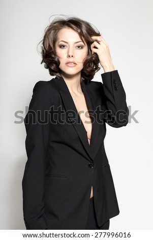 Portrait of gorgeous young caucasian attractive sexy business woman or secretary wearing black jacket